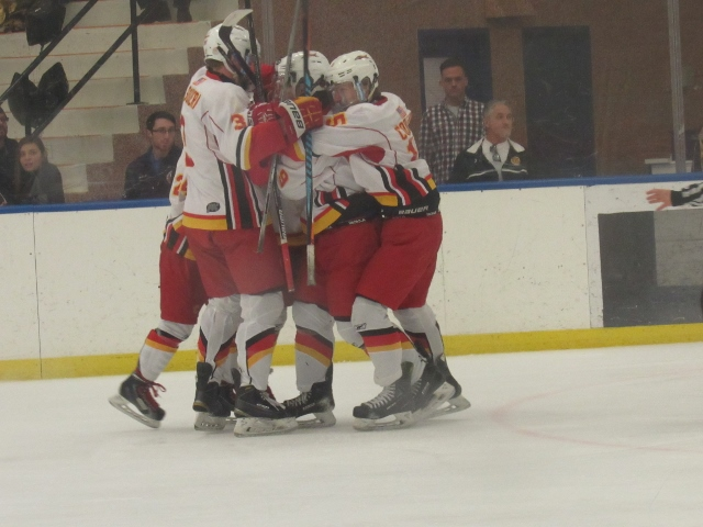 The Chaminade Flyers celebrate a goal by Trevor Radin (Photo by Gregory Giaconelli)