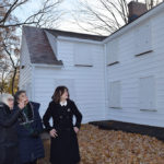 Town Supervisor Judi Bosworth, Marianna Wohlgemuth and Town Councilwoman Lee Seeman examine recently finished siding work on the Schumacher House.