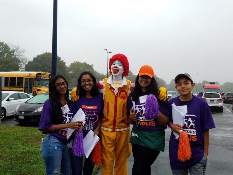 Sewanhaka's Key Club lends a hand at Lupus Walk