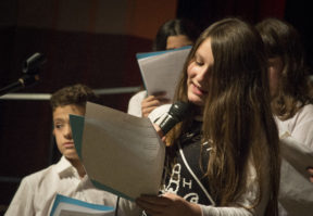 "Alexa Valic, a seventh grader at South Middle School, read quotes from ""Wonder"" before an auditorium of parents."