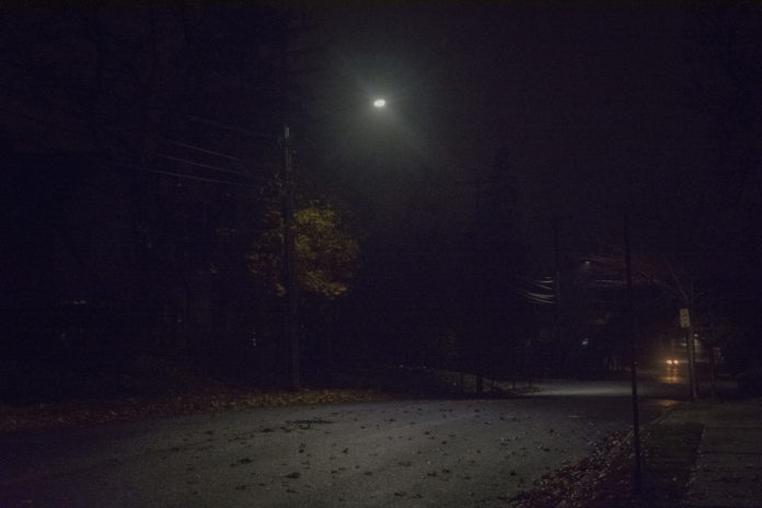 One of the hundreds of LED lights installed throughout the village shines down on a portion of Baker Hill Road, right near Village Hall. (Photo by Janelle Clausen)