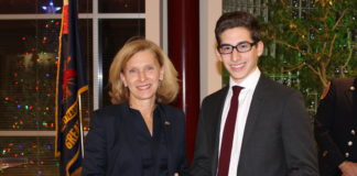 Senator Elaine Phillips presented the New York State Senate's Liberty Medal to Oliver Rein, a 16-year-old Great Neck junior firefighter who extricated two people from a vehicle after the car crashed into a tree in August. (Photo courtesy of state Sen. Elaine Phillips' office)
