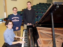 Benjamin T. Rossen is congratulated by Mr. Michael Schwartz, performing arts department head, and Mr. Mark Boschen, instrumental music teacher at South High. (Photo courtesy of Great Neck Public Schools)