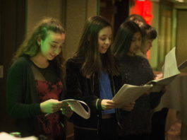 Members of Great Neck High School's choir sang at the Inn at Great Neck's annual Christmas tree lighting party on Wednesday night, a tradition many of them have been involved in since their freshman year. (Photo by Janelle Clausen)