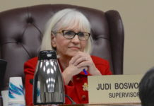 Town of North Hempstead Supervisor Judi Bosworth listens as a resident speaks at a town board meeting. (Photo by Janelle Clausen)
