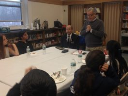 Richard S. Sherman Great Neck North Middle School students listen to wartime stories told by Commander of the Albertson VFW Post 5253 Jack Hirsch and Assemblyman Anthony D'Urso. (Photo courtesy of Assemblyman Anthony D'Urso's office)