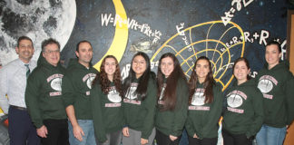 North High Regeneron Scholars Natasha Dilamani, Megan Xu and Amy Shteyman are joined by Principal Daniel Holtzman and science research teachers Alan Schorn, Christopher Bambino, Christina Keys and Maya Lerner, and Science Department Chair Jessica Schust. (Photo courtesy of the Great Neck Public Schools)