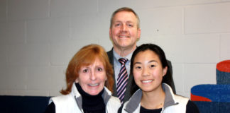 Great Neck South senior Glory Chung is congratulated by Tara Rosenthal, coach of the field hockey team, and Dr. Christopher Gitz, principal of Great Neck South. (Photo courtesy of Great Neck Public Schools)
