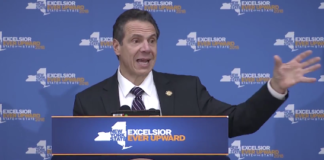"""Governor Andrew Cuomo spoke at the Teamsters Local 282 headquarters in Lake Success on Thursday, framing the Republican tax bill as """"unconstitutional,"""" """"double taxation,"""" and directly aimed at New Yorkers. (Photo still from the Governor's Office)"""