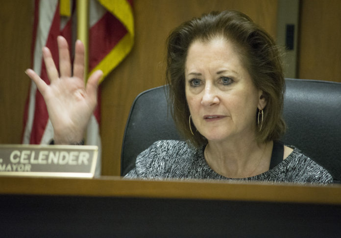 Great Neck Plaza Mayor Jean Celender, along with other members of the Board of Trustees, votes
