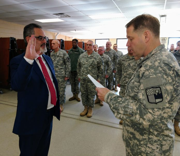 New York Guard Acting Commander Colonel David Warager swears in Robert Duarte of Northwell Health. (Photo by Capt. Mark Getman/New York Guard)