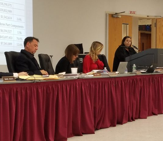 Sydney Freifelder, the assistant superintendent for business, outlines the overall budget before administration heads focus on specific line items. (Photo by Janelle Clausen)