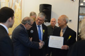 Ren Wen Noodle Factory founder and chairman Ching Sun Wong holds a citation as President Stanley Kwong goes to shake Assemblyman Tony D'Urso's hand. (Photo by Janelle Clausen)