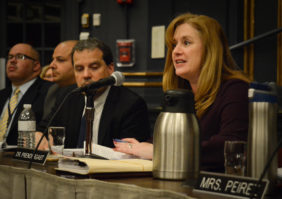 Superintendent of Schools Teresa Prendergast addresses parents at a Monday night board meeting, along with security and building administrators. (Photo by Janelle Clausen)