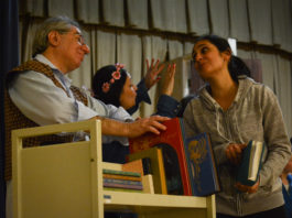 Lillian Rokhsar and Robert Aizer, rehearsing their respective roles of Belle and bookseller, will appear in Temple Israel's upcoming performance of Beauty and the Beast. (Photo by Janelle Clausen)