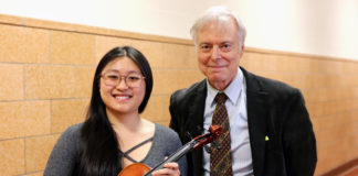 North High violist Megan Xu, chosen for the Honor Orchestra of America, and Mr. Joseph Rutkowski, director of instrumental music at North High. (Photo courtesy of the Great Neck Public Schools)