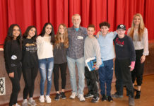 Author Chris Crutcher, in center, is joined by eighth-grade students and Cinthia Serowik, English department head at North Middle. (Photo courtesy of the Great Neck Public Schools)