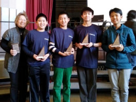 Four South Middle students receive their second-place trophies. (Photo courtesy of the Great Neck Public Schools)