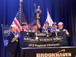 The South Middle team holds their Regional Science Bowl banner and trophy. (Photo courtesy of the Great Neck Public Schools)