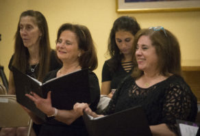 Ann Hirsh and Sherry Husney smile as they perform with their peers at a Shireinu Choir of Long Island rehearsal. (Photo by Janelle Clausen)