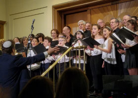 The Temple Israel Children's Choir, under the direction of Cantor Raphael Frieder, sings with the Shireinu Choir of Long Island. (Photo by Janelle Clausen)