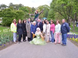 Fairies from the National Circus Project at the Clark Garden Spring Festival pose with local officials. (Photo courtesy of the Town of North Hempstead)