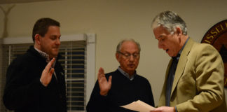 Russell Gardens Mayor Steve Kirschner, right, swears Trustees Matthew Ellis and David Miller into another term. (Photo by Janelle Clausen)