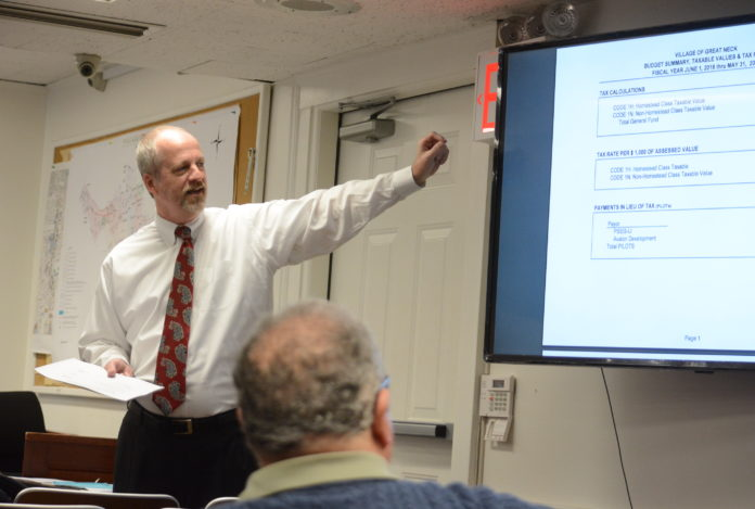 Village Clerk-Treasurer Joe Gill discusses the $9.67 million budget at a Tuesday night board meeting. (Photo by Janelle Clausen)