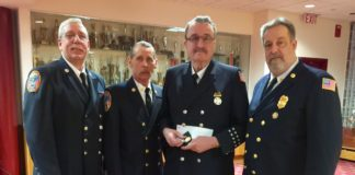 Trustee William McGirr, Chief Steve Schwartz, James Lawrence and President Michael Berry. (Photo courtesy of Great Neck Alert Fire Company)