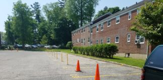 24 parking spots in the southern parking lot of Millbrook Court, which is home to 119 apartment units, remain closed off from residential use. This follows a May 1 meeting where it was hinted it could be re-opened within a few days. (Photo by Janelle Clausen)