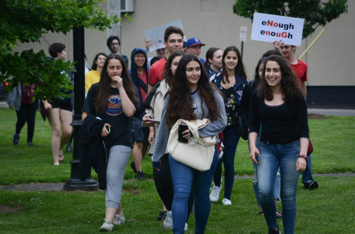 Great Neck North High School students, after working with administrators, walked out of class to rally for gun reform at the Village Green. (Photo by Janelle Clausen)