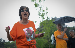 Rita Kestenbaum, wearing a shirt in memory of her daughter Carol, who was killed in 2007 at the University of Arizona, presents a rap to students in attendance about the state of gun violence. (Photo by Janelle Clausen)