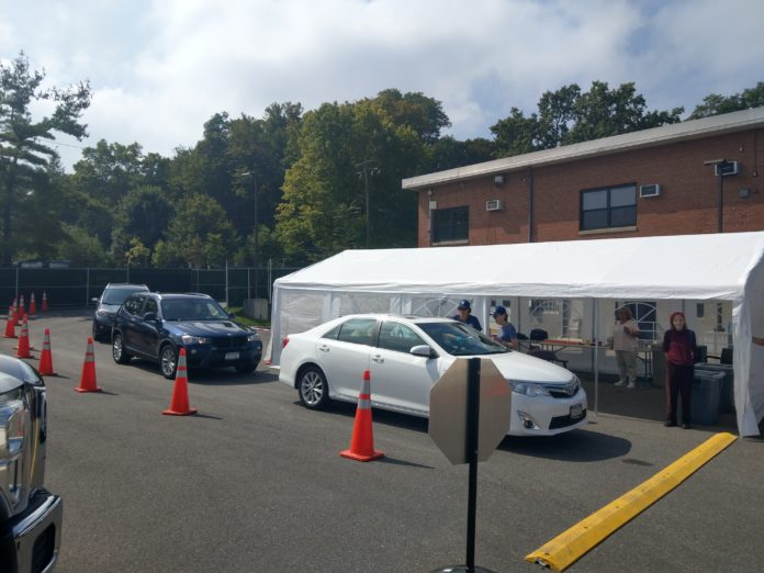 Local residents utilize the Great Neck Water Pollution Control District's free medical disposal drive-thru back in September. The District is set to host its second Shed the Meds event on Sunday, June 3. (Photo courtesy of the Great Neck Water Pollution Control District)
