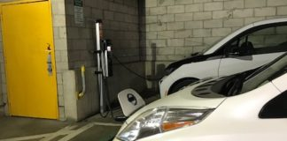 The village's 2017 Nissan Leaf, an electric car, sits parked at a public charging station in a garage. (Photo courtesy of Great Neck Plaza)