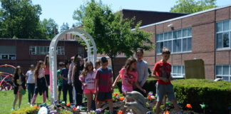 A group of students tour through the newly renovated garden made in honor of Zachary Portnoy, a fourth grader who passed away in 2007. (Photo by Janelle Clausen)