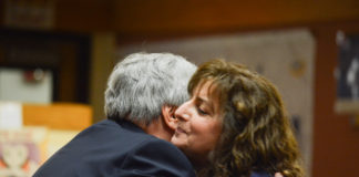 South Middle School Principal James Welsch embraces Carla Diesu, who was later approved for tenure. (Photo by Janelle Clausen)