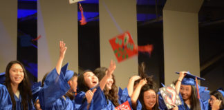 Great Neck South graduates throw their decorated caps into the air, celebrating a new chapter of their lives. (Photo by Janelle Clausen)