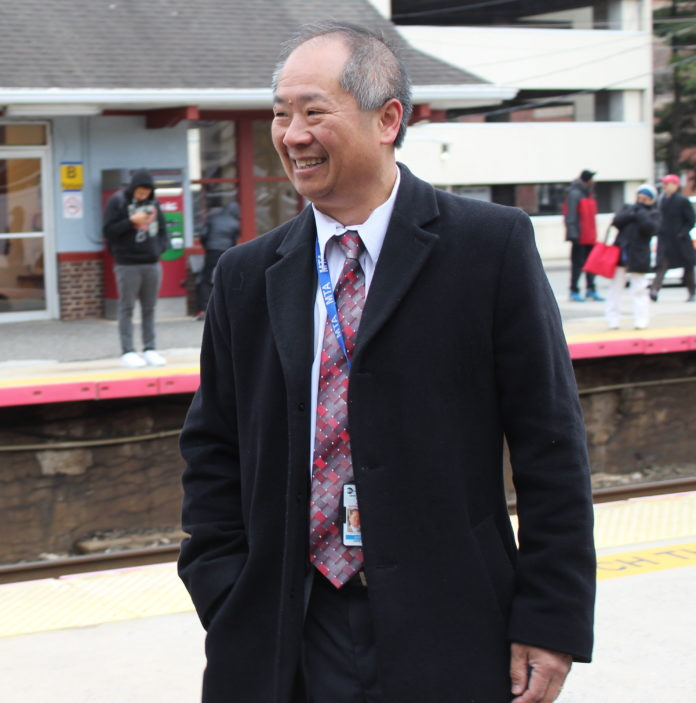 LIRR President Phillip Eng greeting commuters at the Mineola train station. (Photo by Rebecca Klar)