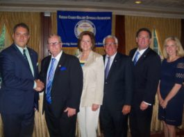 Oyster Bay Town Supervisor Joseph Saladino and Hempstead Town Supervisor Laura Gillen administered the oath of office to Mayor Celender and the NCVOA officers for 2018-2019, including President Ralph Ekstrand, mayor of the Village of Farmingdale, Mayor Celender, 2nd Vice President Edward Lieberman, mayor of the Village of Sea Cliff, and Treasurer Daniel Serota, mayor of the Village of Brookville. (Photo courtesy of NCVOA)
