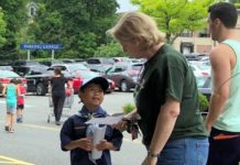 A scout approaches a shopper to try and get donations for the Ronald McDonald House. (Photo by David Lau)