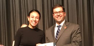 Nassau County Comptroller Jack Schnirman presents the Comptroller's High School Innovation Award to Rebecca Yaminian at John L. Miller Great Neck North High School. (Photo courtesy of the Comptroller's office)