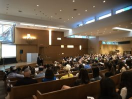 A crowd of parents, Holocaust survivors, and school staff attended a showing of a student-produced documentary telling the stories of Holocaust survivors. (Photo courtesy of Abby Weiss)