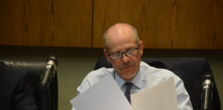 Mayor Adam Hoffman reviews a set of documents during Monday night's board meeting. (Photo by Janelle Clausen)
