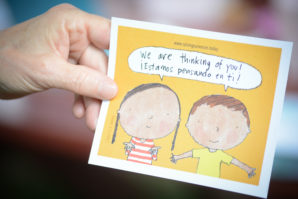 """""""We are thinking of you!"""" this postcard reads """"¡Estamos pensado en ti!"""" (Photo by Janelle Clausen)"""