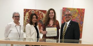 Artist Lauren Skelly Bailey, joined by Great Neck Library Art Committee Chair Pamela Levin, Great Neck Library Director Denise Corcoran and Assemblyman Anthony D'Urso, holds her citation. (Photo courtesy of Assemblyman Anthony D'Urso's office)