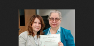 Great Neck Library Director Denise Corcoran presents a Staff Excellence Award to Jennifer Ransom. (Photo courtesy of the Great Neck Library)