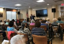 Assemblyman Anthony D'Urso addresses the audience in the Atria Cuttermill's Community Room. (Photo courtesy of Assemblyman Anthony D'Urso's office)