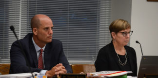 Superintendent of Schools Vincent Butera and Board President Regina Rule listen as students and parents speak. (Photo by Janelle Clausen)