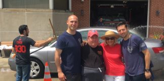 First Assistant EMS Chief Joseph Oginsky, Erin Lipinsky, Supervisor Judi Bosworth and Steve Shapiro at a car wash benefiting Special Olympics New York. (Photo courtesy of the Town of North Hempstead)