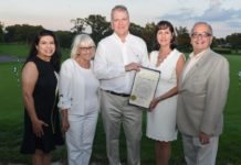Town Councilwoman Anna M. Kaplan, Town Supervisor Judi Bosworth, and honorees Lori and Steve Scrobe with Assemblyman Anthony D'Urso. (Photo courtesy of Assemblyman Anthony D'Urso's office)